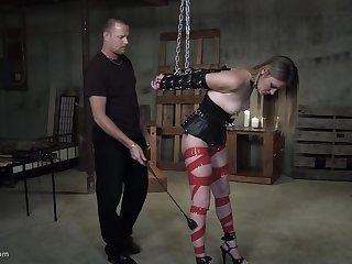 Bondaged slut is unwrought penetrated from behind by her skillful