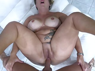 Buxom blunt haired mature blonde Aisha Bahadur gets her pussy pounded
