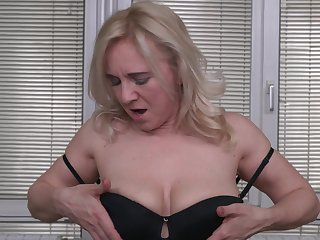 Solely blonde mature layman Alma spreads her shaved pussy on the bed