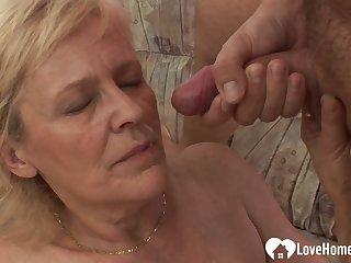Luscious blonde granny takes his raging boner