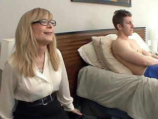 Big Bust cougar Nina Hartley seduces in all directions stockings and a medal