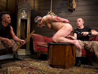 Submissive gay lad endures anal distance from his masters