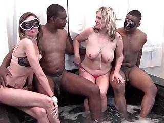 MILFs blowing hard cocks in swinger foursome